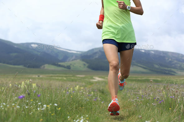 Runner running on grass trail - Stock Photo - Images