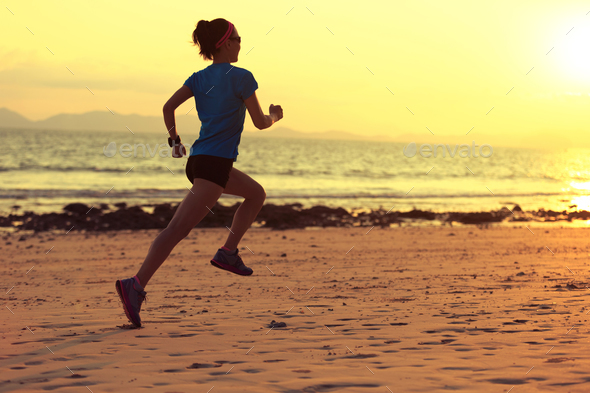 Running on sunset beach - Stock Photo - Images