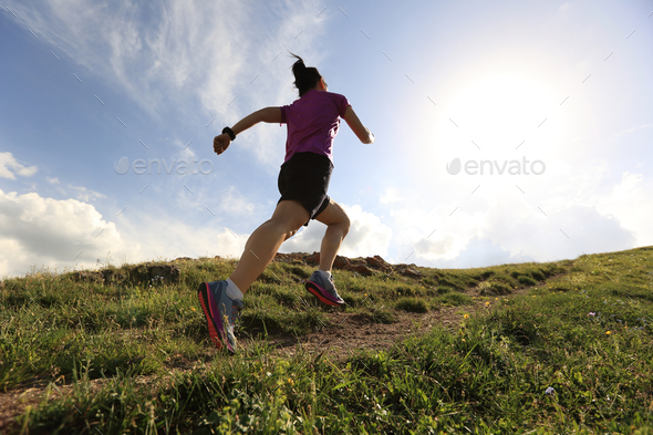 Running to mountain top - Stock Photo - Images