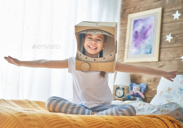 girl in astronaut costume - Stock Photo - Images