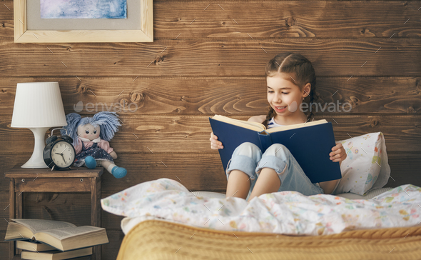 girl reading a book - Stock Photo - Images