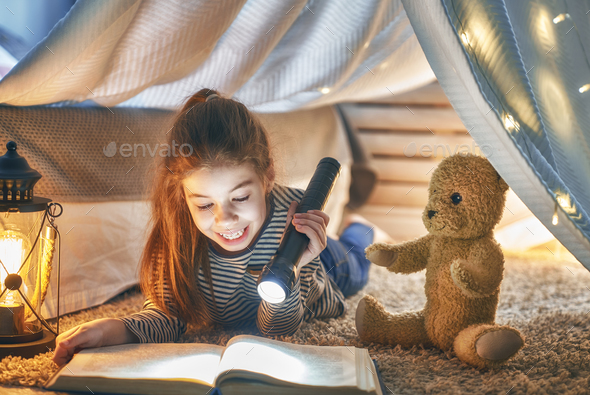 child is reading a book - Stock Photo - Images