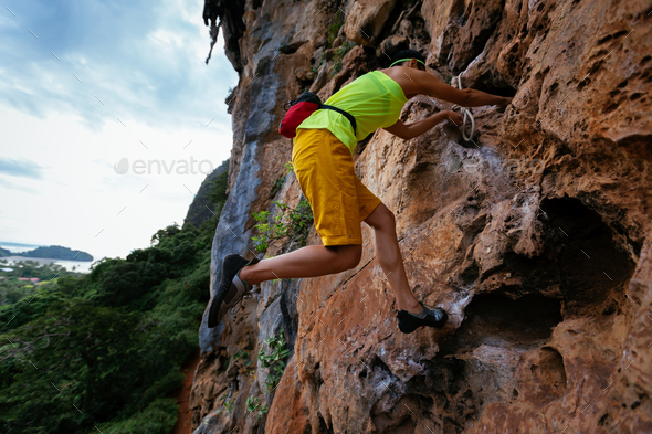 Woman rock climber - Stock Photo - Images