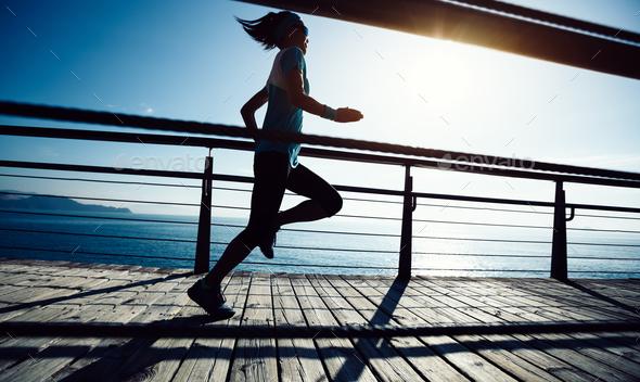 Running on seaside boardwalk - Stock Photo - Images