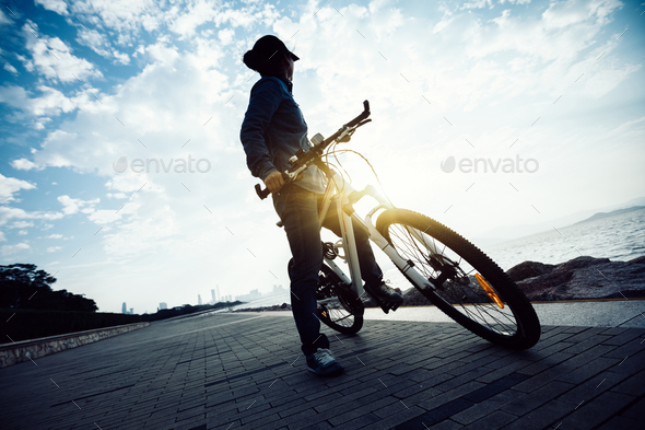 Cyclist looking the sunrise landscape  - Stock Photo - Images