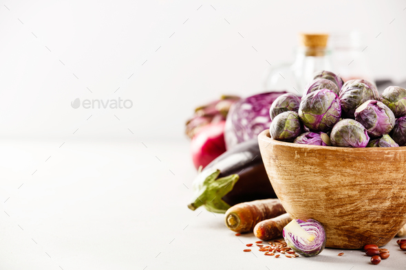 Purple Brussels sprouts in a wooden bowl - Stock Photo - Images