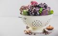 Purple fruits and vegetables in colander - PhotoDune Item for Sale
