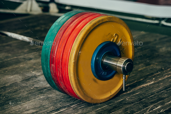 heavy barbell with five plates - Stock Photo - Images