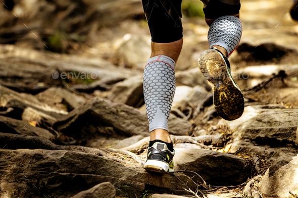 feet male runner in compression calf sleeve - Stock Photo - Images