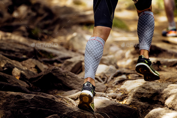 legs runner in compression calf sleeve - Stock Photo - Images