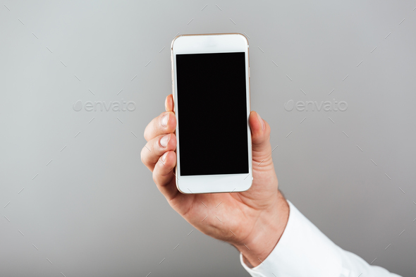 Close up of man showing blank screen mobile phone - Stock Photo - Images