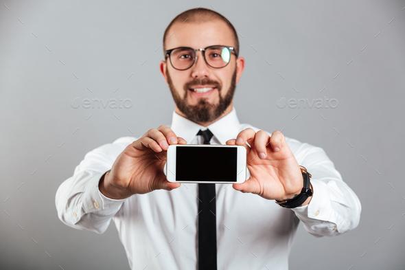 Portrait of a confident businessman - Stock Photo - Images