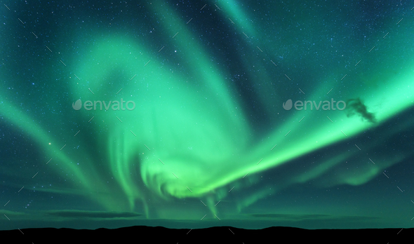 Aurora borealis and silhouette of hill. Lofoten islands, Norway. - Stock Photo - Images