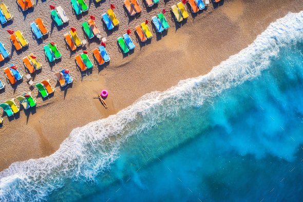 Aerial view of lying woman with swim ring in the sea in Oludeniz - Stock Photo - Images