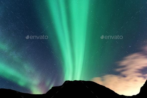 Aurora borealis and silhouette of mountains. Lofoten islands, No - Stock Photo - Images