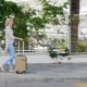Woman with Travel Bag Goes Along the Resort Area. It Goes Along the Fence, Which Was Overgrown with - VideoHive Item for Sale