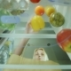 A Young Woman Loads the Food in the Fridge. Opens the Door of the Refrigerator and Puts There Just - VideoHive Item for Sale