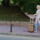 Woman with Travel Bag Goes Along the Resort Area. On a Clear Sunny Day - VideoHive Item for Sale