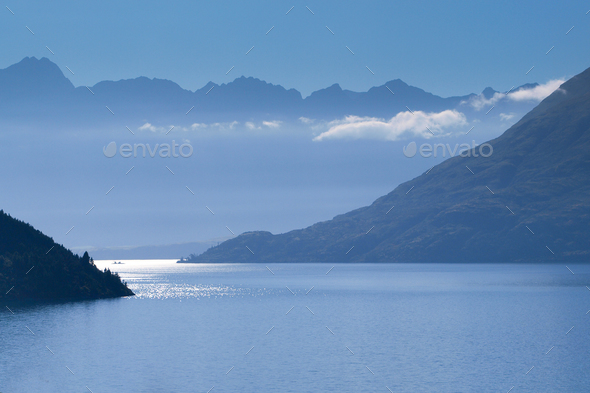 Blue Haze Lake and Mountains - Stock Photo - Images