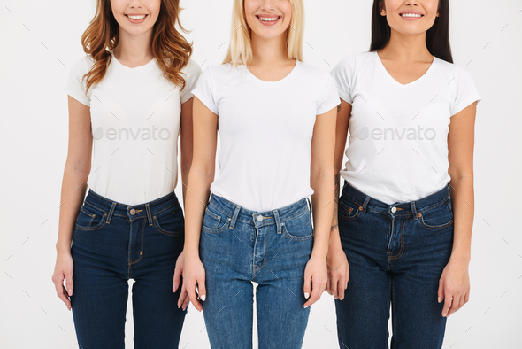 Cropped image of three smiling casual girls - Stock Photo - Images