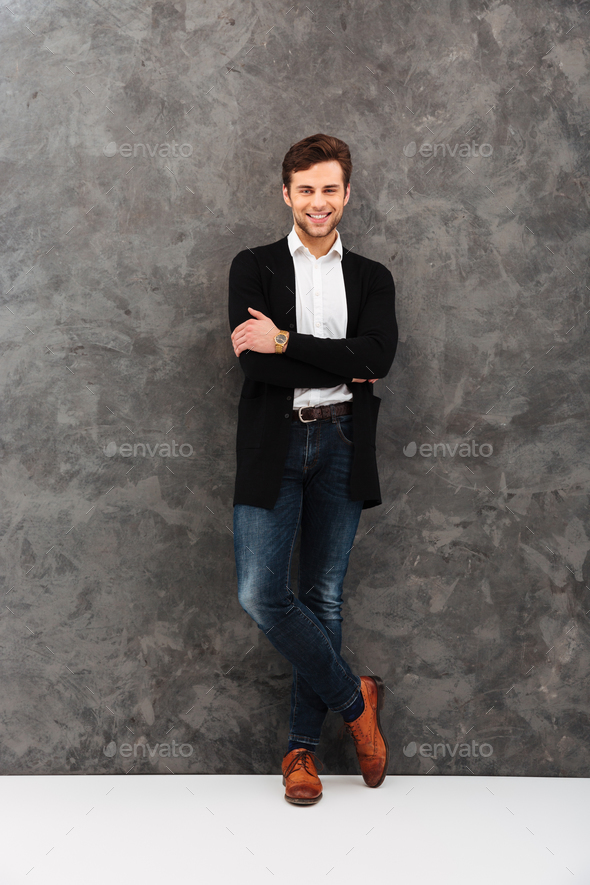 Happy young businessman looking camera. - Stock Photo - Images
