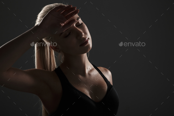 Side view of a tired fitness woman dressed in sportswear - Stock Photo - Images
