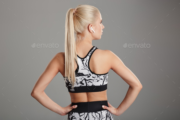 Back view portrait of a blonde young sportsgirl - Stock Photo - Images