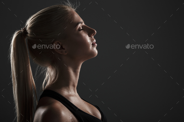 Side view of a smiling fitness woman - Stock Photo - Images