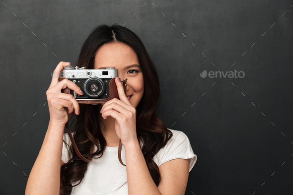 Asian young happy woman photographer - Stock Photo - Images