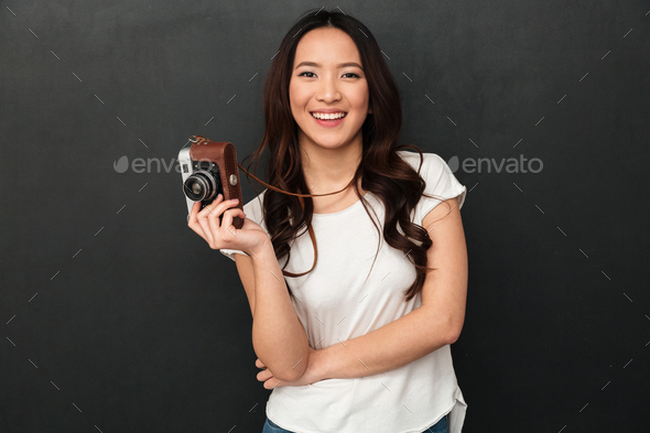 Cute asian young woman photographer - Stock Photo - Images