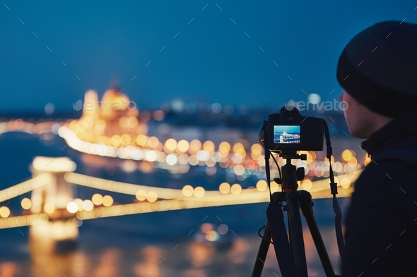 Photographer in the night city - Stock Photo - Images
