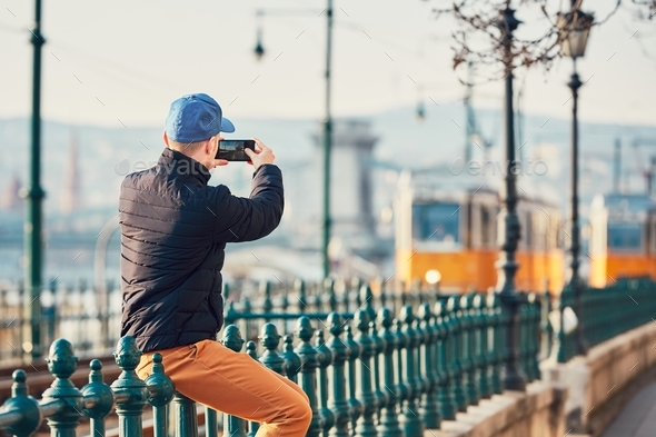 Tourist taking pictures with smart phone - Stock Photo - Images