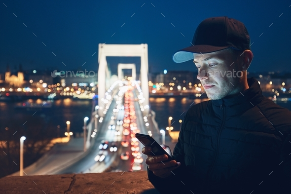 Young man reading text message - Stock Photo - Images