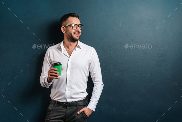 Happy man standing over dark blue background - Stock Photo - Images