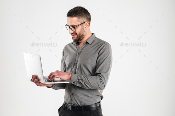Happy man using laptop computer. - Stock Photo - Images