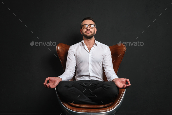 Concentrated businessman meditate. - Stock Photo - Images