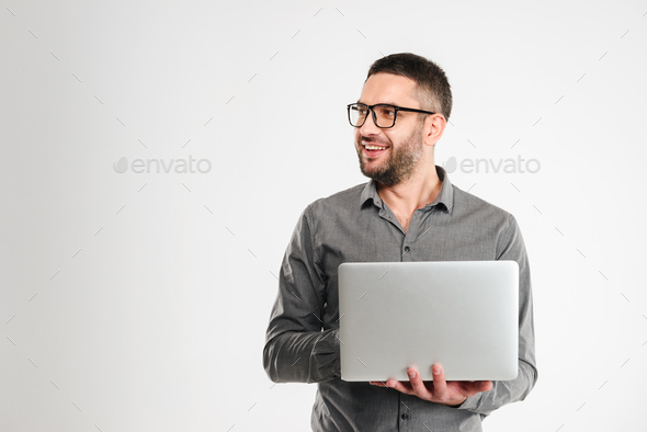 Concentrated businessman using laptop computer. - Stock Photo - Images