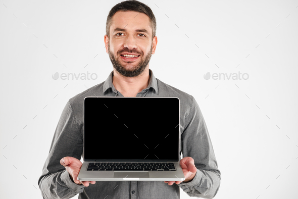 Businessman showing display of laptop computer. - Stock Photo - Images