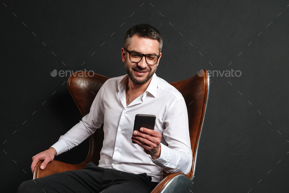 Happy businessman chatting by phone. - Stock Photo - Images