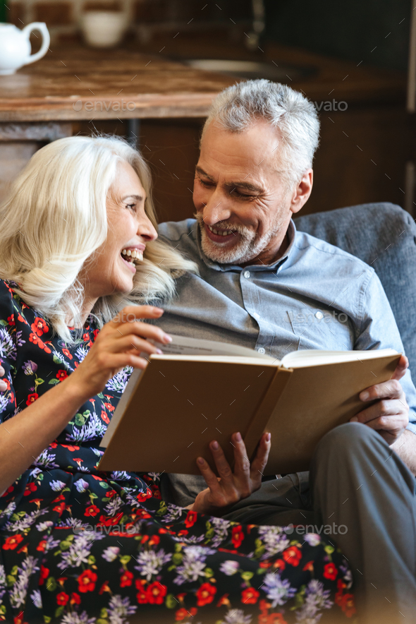 Portrait of lovely old couple 60s resting together at cozy home, - Stock Photo - Images