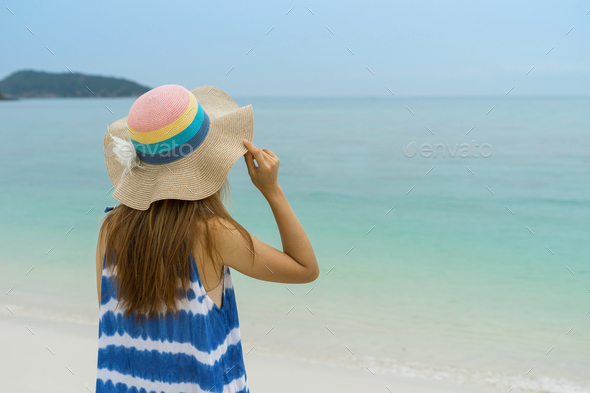 Young woman relaxing and enjoying at the tropical beach, Summer vacation and travel concept - Stock Photo - Images