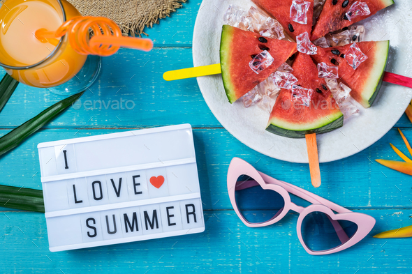 Women's casual clothes with accessories items and tropical fruits - Stock Photo - Images
