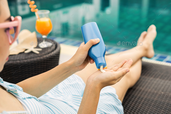 Woman applying sunscreen lotion, Summer vacation concept - Stock Photo - Images