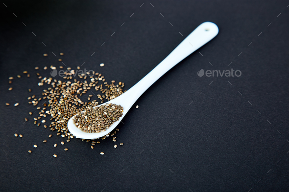 Chia in white spoon. - Stock Photo - Images