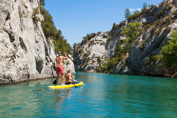 People doing standing paddle in  Gorge du Verdon canyon river in - Stock Photo - Images