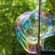 Arstist blowing colorful giant soap bubbles outdoor - PhotoDune Item for Sale