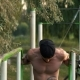 Young Man Performs a Power Exercise On Uneven Bars. - VideoHive Item for Sale