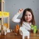 A Cute Girl Playing with a Dollhouse - VideoHive Item for Sale