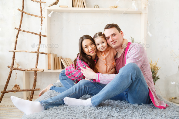 Happy young family portrait. - Stock Photo - Images