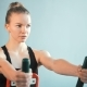 Sporty Woman Doing Exercises To Strengthen the Muscles of the Back at the Gym - VideoHive Item for Sale